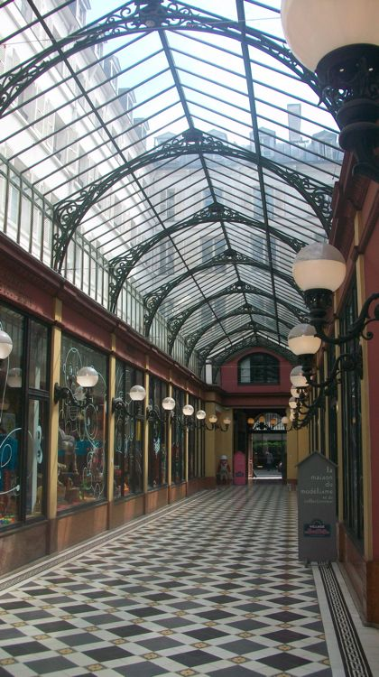 Walking through one of Paris' magical arcades.