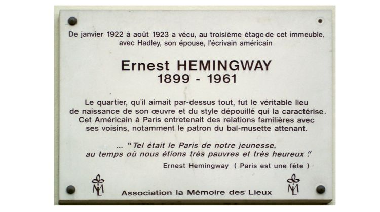 Hemgingway memorial plaque noting residence of the American writer in Paris, France.