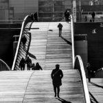 Walking across the Pont de Bercy, Paris, France.
