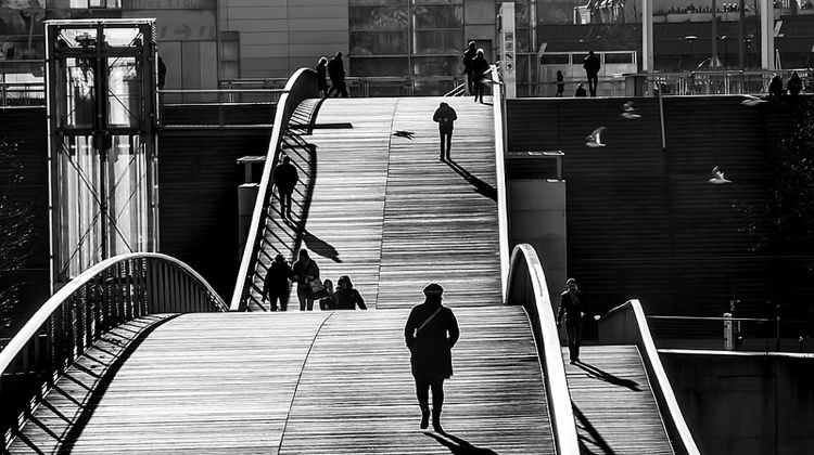 Walking across the Pont de Bercy, Paris, France.