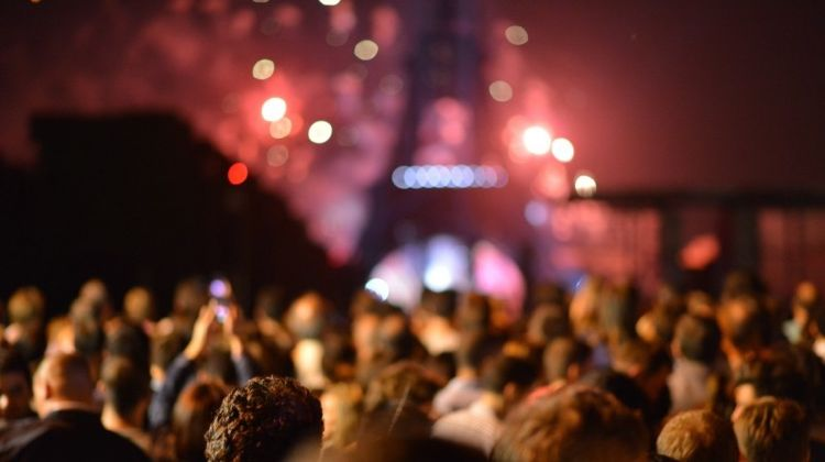 New Year's in Paris. People celebrating infront of the Eiffel Tower.