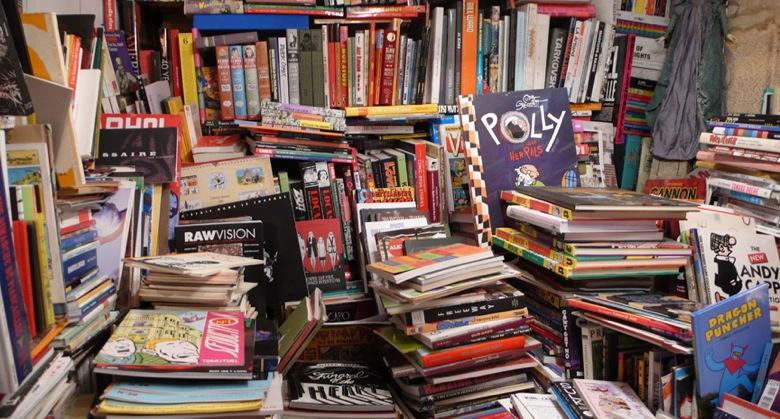 Piles of books at Paris bookshop, Un Regard Moderne, 10 Rue Gît-le-Cœur, 75006 Paris