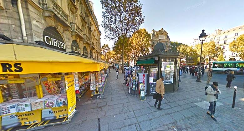 Newstand in Place Saint-Michel, Paris, via Google Maps View: https://goo.gl/maps/EWRUPyB4bpE2